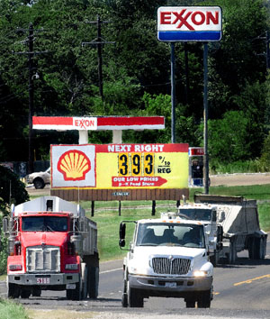 Photo of trucks and sign of gas prices