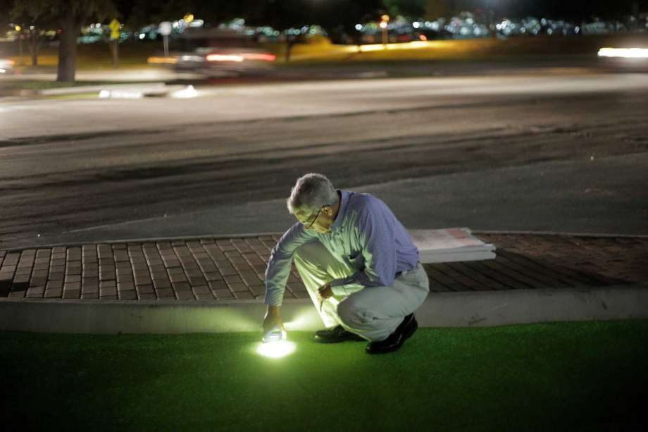 Robery Brydia tests luminocity of green paint with phone at night